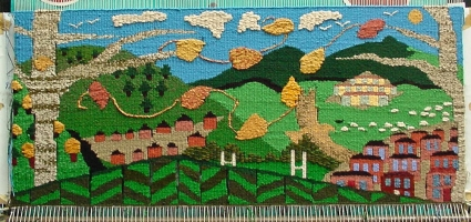 <p>Communal Weaving Project</p>